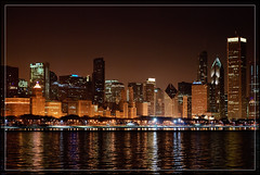 Big City Lights (Waqas S.) Tags: park lake chicago reflection skyline night buildings reflections lights downtown skyscrapers nightshot grant shoreline lakemichigan nighttime bling greatlake windycity