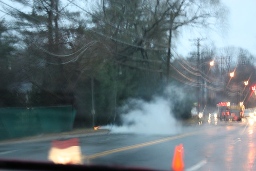 Apologies for the blurriness: a downed power line ignites a fire.
