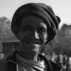 Man at market, Inle Lake, Myanmar. (ndnbrunei) Tags: travel blackandwhite bw 120 6x6 tlr film rollei mediumformat square kodak burma bn mf inlelake xenar rolleicord classicblackwhite analoguephotography rolleigallery ndnbrunei tmy2 kodak400tmy2 50yearoldcamera ilovemyrolleicord