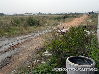 Barren farmland outside the factory