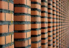 Repeating Bricks (JTContinental) Tags: seattle red urban detail brick architecture vanishingpoint dof repetition bigmomma challengeyouwinner thechallengefactory jtcontinental herowinner ultraherowinner
