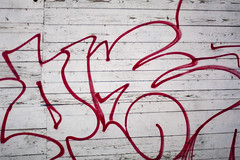 Red graffiti writing on wooden wall (Horia Varlan) Tags: park red wall night writing graffiti drawing letters nails spraypaint outline woodplanks