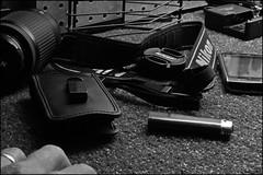 Manville - Clutter (stryderphoto) Tags: nikon blackberry cellphone lighter lenscap myhand camerastrap manville nikonlens nikonbatterycharger nikonnikkor55200mmlens astroturfthatonesforyoummytonhaha