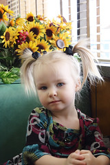 20100325_2068_Pandora (missravenx) Tags: flowers baby cute breakfast toddler child sweet eating adorable diner sunflowers messy eggs syrup pigtails pandora petes