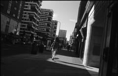 (bleekism) Tags: light shadow sky man london buildings square shine side spotlight cast solo lone edgwareroad unilateral kodakt400 prakticatl5b