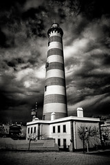 Darkness Falls (Coussier) Tags: blue sky bw sun lighthouse white tree green folhas sol portugal azul clouds dark happy darkness stripes sunny cu nuvens riscas rocket feliz farol erection arvore alegre folha nuvem leafes barra outono aveiro autom costanova colorphotoaward