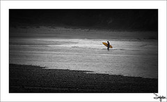 The Surfer (diegogm.es) Tags: sea espaa seascape beach marina atardecer mar spain sand agua asturias playa paisaje gozon olympus arena nubes zuiko roca piedras oceano xago piedra cantabrico 1442 pedreo surfero e520