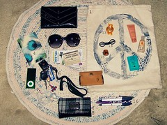 in my bag (theweepytiki) Tags: sunglasses vintage bag notebook keys junk ipod random wallet pens americaneagle tote lotion
