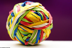 Banded together! (dj murdok photos) Tags: abstract macro art colors yellow closeup ball fun aperture dof purple sony blues greens alpha reds rubberbands bokek a700