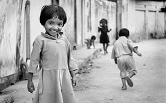 an overwhelming smile (ioannis lelakis) Tags: 2002 bw copyright india film girl smiling kids canon children force little south young moment crossroad suprise pondicherry spontaneous captivating ioannis overshine lelakis periaveerampattinam