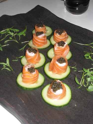 Salmon sashimi with caviar, served on a cucumber crisp.