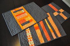 Placemats (before washing) (texas freckles | Melanie) Tags: orange charcoal quilted scraps patchwork kona placemats