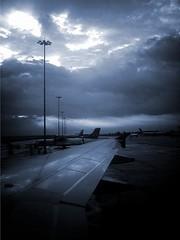 Murky (legends2k) Tags: morning blackandwhite southwest monochrome plane lumix wings cloudy aircraft flight aeroplane panasonic g1 runway murky lampposts fourthirds turbid microfourthirds panasonicdmcg1