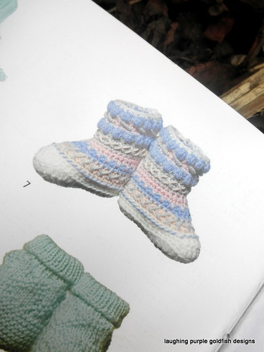 booklet, bootee - closeup