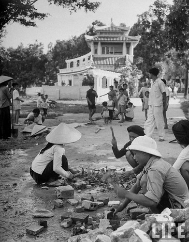 Hanoi 1948 - Natives repairing road, in French Indo China.