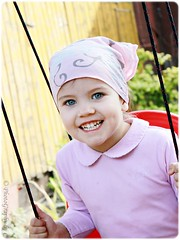 ~ joyful ~ (Cornelia Anghel) Tags: portrait smile playground canon play outdoor happiness explore 1855mm joyful portret onexplore joaca explored zambet fericire inexplore canoneos500d leagan photographybyc photographybyc