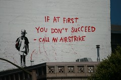 If At First... (colonelchi) Tags: sanfrancisco california city trip roof vacation urban streetart art northerncalifornia wall graffiti stencil artist pieces child famous banksy saying urbanart bayarea gasmask stencilart graffitiart famousartist urbanarea artpieces
