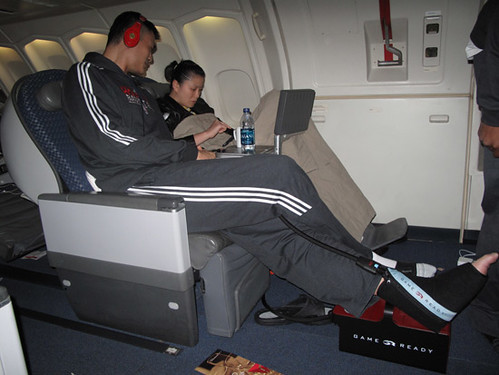 October 12th, 2010 - Yao Ming and wife Ye Li recline on the long flight from Houston to Beijing for the China Games