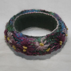 Purple Daisies - Bangle (Lynwoodcrafts) Tags: flowers flower wool floral felted purple recycled embroidery felt textile bracelet daisy bangle knitted embroidered handstitched handknitted fulled handembroidered textilejewelry tapestrywool knittedjewelry embroideredjewelry