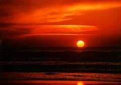 Manzanita Sunset (suecollins46) Tags: ocean sunset orange sun beach clouds manzanitaoregon