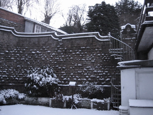coachhouse in snow - coutryard wall