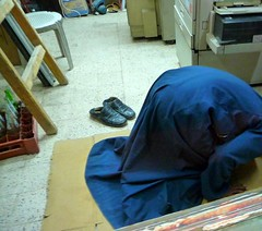 muslim shop keeper praying on card board with shoes off (Ginas Pics) Tags: man smart horizontal person shoes muslim traditional prayer religion pray praying egypt indoors cardboard inside tradition shoesoff luxor mecca shopkeeper prostrating ginaspics manpraying unrecognizablepeople peoplepraying reginasiebrecht