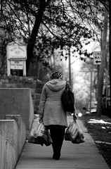 woman carrying groceries (Barbara.K) Tags: street blackandwhite woman shopping candid tired heavy load groceries carrying bloomingtonin tamron18200mm e2ndstreet eos500d canonrebelt1i