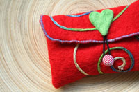"red felt card pouch...""circus"" ... renewing the senses"
