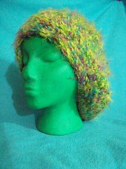 101_1021 (CrazyHatSociety) Tags: charity green animals yellow haiti hats frogs giraffes etsy donations ravelry crazyhatsociety crazyhatsocietyetsycom