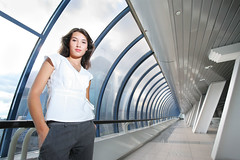 Confident businesswoman in futuristic interior. (blknauss) Tags: windows portrait sky people woman white girl beautiful horizontal architecture female clouds buildings asian person corporate one marketing office hands long skyscrapers angle adult interior unitedstatesofamerica tube wide young tunnel corporation business single future round workplace concept copyspace pocket russian development futuristic confident confidence caucasian businesswoman