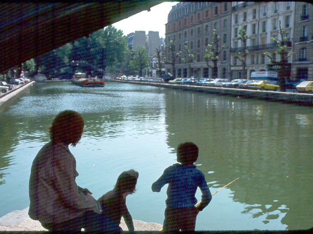 Parisians fishing in canal