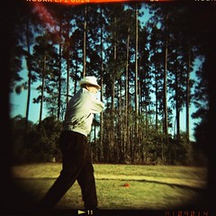 Swingin' (anmyk) Tags: trees tree 120 6x6 film pine mediumformat golf toy holga lomo xpro lomography crossprocessed junk exposure cross kodak cone crossprocess south toycamera grandfather deep balls swing course southern squareformat processing swinging grandad expired vignetting ektachrome processed exposed golfer plasticcamera octogenarian 120n deepsouth plasticlens plasticlense e6toc41 anomyk
