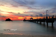 Sebuah Perjalanan. (mohd.ayub) Tags: longexposure blue sunset sky copyright evening jetty sigma tioman pulau pahang 2010 uwa sillhoute d90 mohdayub