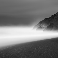 Rainy Rodeo Sunrise #2 (maxxsmart) Tags: ocean california longexposure bw seascape water rock fog clouds contrast umbrella sunrise canon coast blackwhite haze sand rocks rage bay