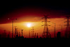 """""""In the twilight, it was a vision of power."""" (Sanctuary photography → back ! maybe :p) Tags: light sunset red sky orange sun black colors silhouette yellow clouds twilight explore burn hues powerful electrictowers explored 37♥washere inthetwilightitwasavisionofpower"""