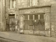 SO.LAN.CO (Annie in Beziers) Tags: urban france abandoned sepia silk explore textures languedoc decayed shopfront hrault bziers annieinbziers