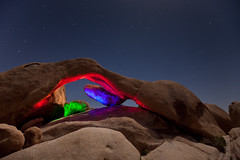 Light Painting at Natural Arch (Jeffrey Sullivan) Tags: california copyright usa lightpainting tree nature colors night landscape march photo nationalpark colorful arch desert joshua joshuatree southern allrightsreserved 2010 naturalarch archrock jotr jeffsullivan mountainhighworkshops sullivanworkshop