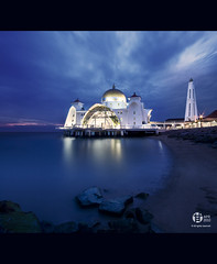 Floating Mosque Malacca (Tomatoskin) Tags: sunset sea cloud reflection rocks pov mosque malaysia bluehour kam floatingmosque structure floating pulaumelaka sigma10mm20mm canoneos40d masjidselatmelaka malaysiatrulyasia tomatoskin vertorama bluehourmalacca locationmalacca