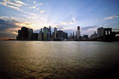 New York City (mudpig) Tags: nyc newyorkcity bridge sunset cloud newyork reflection skyline geotagged cityscape southstreetseaport brooklynbridge eastriver fdrdrive hdr pier17 mudpig stevekelley