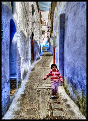 The Little Red Girl ! (Bashar Shglila) Tags: old city blue red mountain mountains girl town little morocco maroc chaouen walls chefchaouen marruecos rif chefchouen chouen           mygearandmepremium