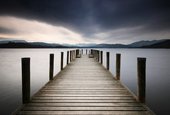 Jetty to the hills (Semi-detached) Tags: wood sky bw lake water landscape wooden nikon long exposure district jetty cumbria brooding windermere broody d300 nd1000 nd110