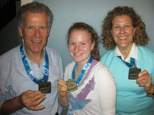 Ron Foreman, Devon Moir, Bev Moir, with our Sporting Life 10K Medals