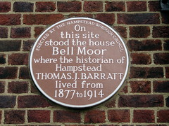 Photo of Thomas J. Barratt brown plaque