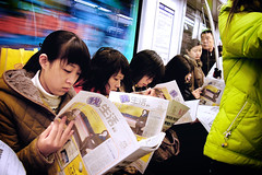 compulsive readers   (badbrother) Tags: china woman yellow female newspaper women metro candid chinese strangers streetphotography commuter lime nanjing    smcpda1855mmf3556al