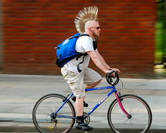 Mohawk rider (jeremyhughes) Tags: road street city urban haircut motion london bike bicycle speed trek hair cycling movement nikon punk cyclist mountainbike style mtb mohawk messenger nikkor courier panning hairstyle rider punky messengerbag mohican courierbag d40 nikond40