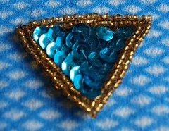 Blue sequinned triangle