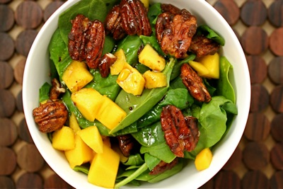 spinach salad with mango and candied pecans