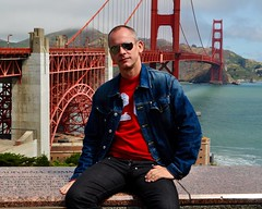 Carl in Black Button-fly Jeans on the Golden Gate Bridge in San Francisco, California (Blue Rave) Tags: sanfrancisco california bridge blue red people color colour male men guy face sunglasses sitting dude jeans jacket goldengatebridge mate jeanjacket thecolorblue bloke 2010 buttonfly bluejacket thecolorred meninjeans buttonflyjeans