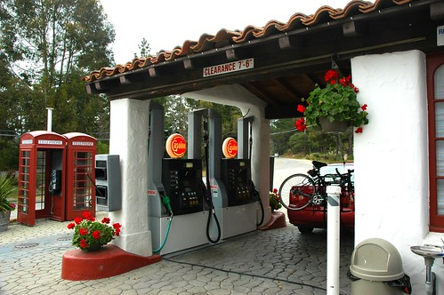 Red Phone booths, at a hobbit-like gas station - my red Toyota with bike driving north from Guadalajara, Mexico to Seattle, Washington - Carmel Highlands, Southern California Coast, USA by Wonderlane
