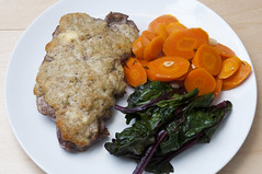 Steak, beet greens and carrots